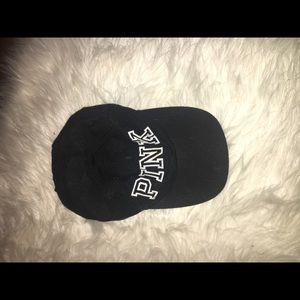 Black and white baseball cap. Says PINK